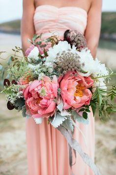 Coral Charm Peony Bouquet | Coastal England Wedding Inspiration | See more on Style Me Pretty: http://www.StyleMePretty.com/destination-weddings/2014/03/13/coastal-england-wedding-inspiration/ Photography: Sarah Falugo | Floristry Design: The Blue Carrot