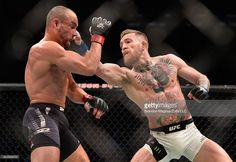 Conor McGregor of Ireland punches Eddie Alvarez in their UFC lightweight championship fight in their UFC lightweight championship fight during the UFC 205 event at Madison Square Garden on November 12, 2016 in New York City.