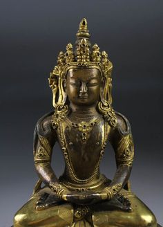 A rare gilt bronze figure of Buddha Amitayus. Sino-tibetan. Qing Dynasty Buddha Amitayus seated in vajrasana on a very rarely seen high double-lotus