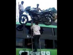 Indian Superman Carries A Bike Over His Head - YouTube