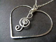 I Love Music Necklace Heart Charm Necklace G Clef Charm Pendant Sterling Silver Wire Wrapped Figure Eight Chain Unique Music Lovers by NKCollections on Etsy https://www.etsy.com/listing/119461728/i-love-music-necklace-heart-charm