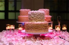 Fabulous pink wedding cakes with flower petals and candles, Wedding by Southern Event Planners, Memphis Weddings
