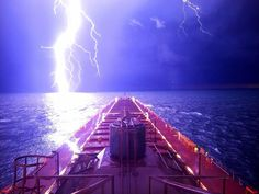 This A dramatic photo of a thick lightning bolt illuminating the night sky as it seemingly touches Lake Michigan has been taken by Jack Brandenburg on August 28 2018 State Of Michigan, Lake Michigan, Wisconsin, Cell Phone Companies, Sturgeon Bay, Dramatic Photos, Epic Photos, Best Cell Phone, Vacation Places