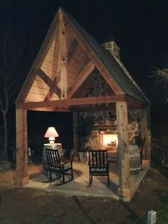 Backyard Fireplace, complete with a roof and rocking chairs.