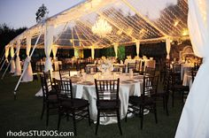 Clear tent wedding with a crystal chandelier. #BellaCollina #BellaCollinawedding