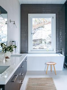 Square and clean-lined, this tub evokes the minimalist look of a Zen spa. Keep things simple with an exterior faucet, leaving more space to lean back and relax.
