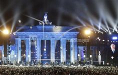 Balloons of the art installation 'Lichtgrenze 2014' fly away in front of Brandenburg Gate during the central event commemorating the fall of the wall in Berlin, Germany, Sunday, Nov. 9, 2014. 25 years ago - on Nov. 9, 1989 - the East-German government lifted travel restrictions and thousands of East Berliners had pushed their way past perplexed border guards to celebrate freedom with their brethren in the West. (AP Photo/Michael Sohn)