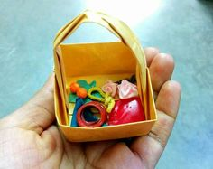 Token of art - Origami basket with tiny goodies as return gift to the ladies who paid a visit during Lakshmi pooja