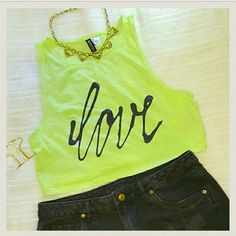 Forever 21 graphic crop top Perfect condition. Worn once to a Miley Cyrus concert. Super cute on, runs small. I usually wear a size small with a 34 bust.  bright neon yellow/ greenish color Forever 21 Tops Crop Tops