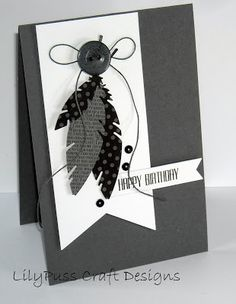 handmade card from LilyPuss Cards ... black and white ... die cut feathers ... black base card ... black string and bling ... geat card!! ...Use twig in place of button...