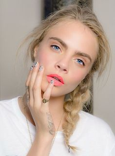 One way to celebrate the summer festivities is with a coral lip and messy braid.
