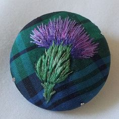 This little thistle was embroidered on Campbell tartan silk. I used stranded cottons but felt they needed highlighting as the tartan was quite dark so I added some metallic thread stitches. Silk Ribbon Embroidery, Embroidery Applique, Cross Stitch Embroidery, Embroidery Patterns, Embroidery Thread, Campbell Tartan, Broderie Simple, Fabric Brooch, Art Textile