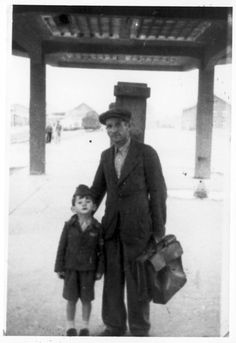 Dachau, Germany, Buchenwald survivor Benyomin and his father at the train station.