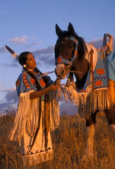 Shoshone Woman in Beaded Regalia and Horse Tack