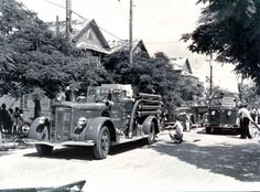 Fire trucks from the Key West Navy fire department and the Key West Fire Department on Whitehead Street - Key West, Circa 1952