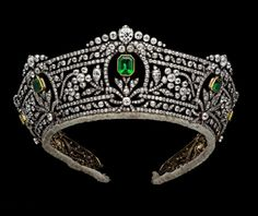 Boucheron Harcourt Tiara. Gold, silver and diamond tiara, the base and top outlined by channel-set diamonds enclosing a continuous line of ribbons, the space between filled with seven emeralds with rectangular cut corners within open oval frames graduated in size towards the back. These are surmounted by groups of collet-set diamonds and supported below by leafy sprays linking the emeralds The emeralds have been replaced. Boucheron, Paris 1900-1913. Go to source for further info.