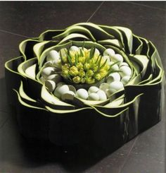 Easter arrangement - tulips in the centre, eggs and green around - Bart van Hove