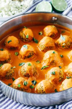 "Thai Red Curry Chickpea 'Meatballs""- fresh ginger, carrots and garlic are blended with chickpeas and served with a creamy red curry sauce for a satisfying and flavorful plant-based meal. (gluten-free)"