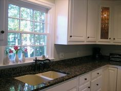 White cabinets + dark granite = the dream! @Michelle Flynn Flynn Flynn Flynn.