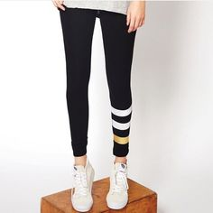 """Sundry Metallic Stripe Yoga Pants •Sundry sets the direction with these white and metallic striped leggings that'll blitz your next yoga session. Elasticized banded waist, contrast stripes on left lower leg.   •Sundry Size 2 = Size Medium, runs a bit small and will work for a 4/6 or S/M. Inseam 28"""", Waist laying flat 11.5"""".  •Sundry Size 3 = Size Large, runs a bit small and will work for a 6/8 or M/L. Inseam 28"""", Waist laying flat 12.5"""".  •New with tags.  •NO…"""