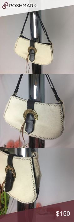 Casadei pony hair purse Gorgeous pony hair purse with leather buckle. Extremely well made. Magnetic snap closure. Roomy lined interior with zipper pocket. Timeless. In perfect condition Casadei Bags Mini Bags