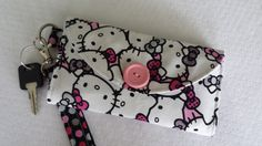 Hello Kitty! Perfect on-the-go wristlet to hold all your basics - cash, credit cards, license and cell phone. Great for walkers and attaches to baby stroller