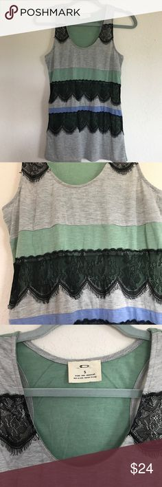 "Anthropologie Pins and Needles Lace Inset Tank Pretty striped tank by Pins and Needles with black lace accents. Excellent pre-loved condition, no flaws to note. Size S, approx measurements: 15"" at armpits, 26 1/2"" long. 65 rayon/35 poly with 100% nylon contrast. Anthropologie Tops Tank Tops"