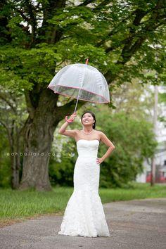 rainy wedding, rain, bride, umbrella bridal, bridal photography, rainy wedding ideas, rainy day posing, posing in rain, bridal pose, wedding dress, bridal gown, www.leahbullard.com