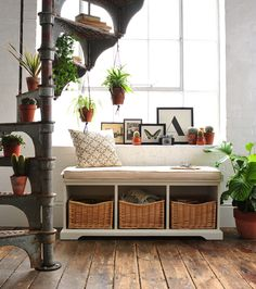 White hall bench, painted furniture, clever storage, plants, macrame, spiral staircase, dream home, cacti, cactus, succulents, spider plants, hanging plants, monochrome prints