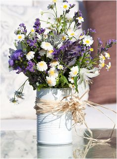 rustic flowers in tin can vase