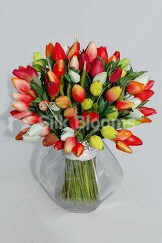 http://www.silkblooms.co.uk/floral-arrangements/100-fresh-touch-tulip-vase-arrangement-display-in-reds-yellows-6508
