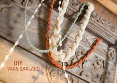 DIY: Yarn Garland. I love this! Mix it up with strings of pearls, etc, and it's very elegant.
