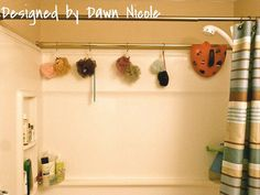 An extra shower curtain rod at the back of the shower for hanging wet puffs, towels or bathing suits