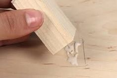 This is an simple attachment. He/she has simply added some PVA glue and stuck it to another piece of wood