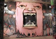 Street art face with broken teeth painted by Nikita Nomerz
