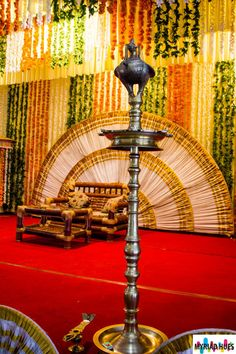 Vibrant Indian stage decor, complete with the peacock lamp typical of Kerala #indianwedding #engagement