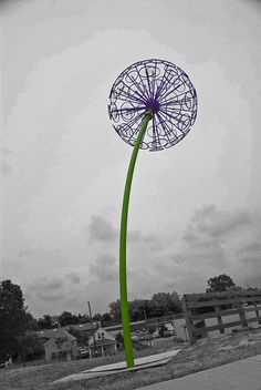 A giant dandelion crafted out of bicycle wheels sits along Route 77 in Cleveland.