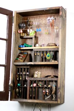 "Rustic window hidden jewelry organizer. Threaded rod + nuts = tiny tension rod for hook earrings and 3/4"" ""S"" hooks (necklaces)."