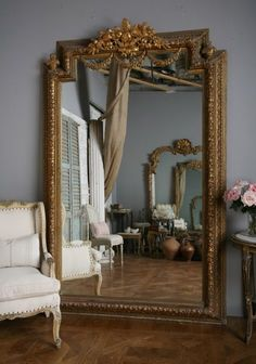 two similar mirrors on opposite sides of a room like two similar souls reflecting on each other ...can be mesmerizing...