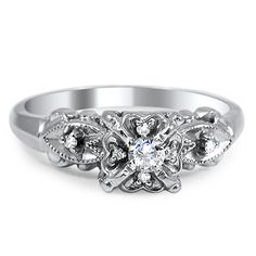 The Jamille Ring from Brilliant Earth - love the character of this and if the center diamond were square this would be even better