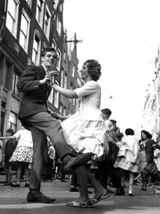 Dancing at the Bloemgracht in the Amsterdam neighbourhood the Jordaan, ca. 1950-1960. Exhibition Dansen, dansen, dansen in Amsterdams Historisch Museum, 2001/2