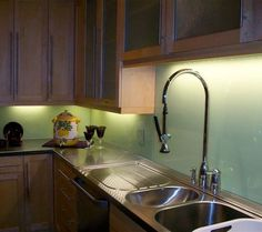 kitchen idea of the day stainless steel backsplash. Black Bedroom Furniture Sets. Home Design Ideas