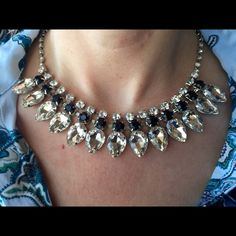 "Rhinestone and Black Crystal Statement Necklace Rhinestone and rhinestone and rhinestones, oh my!  A stunning necklace suitable for a formal event, wedding or date night out, this piece features 13 large clear crystals and 13 black crystals with a complete rhinestone count of 51 across the full length. Total length is 16.5"" with a 3"" extender. Clear and black crystal center design measures 6"". Setting is silver toned. Additional photos and questions answered upon request. Bedecked &Bedazzled…"