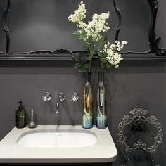 Go for drama in your bathroom by painting it all black. Finish the look with an ornate mirror and chair for total relaxation.
