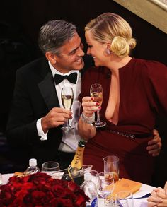 George Clooney and host Amy Poehler canoodle while sipping Moet & Chandon champagne at the Golden Globes Awards in Los Angeles, Calif., on Jan. 13.