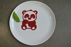 Using beetroot, we printed a cute panda bear plate decoration, added some basil, and then we are going to plate up other food on it for lunch. Yet another fun way to encourage people to eat beetroot. :-)