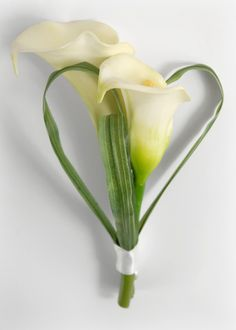 """Calla Lily Boutonniere $6 each / 3 for $5 each    Calla Lily Boutonniere $6 each / 3 for $5 each    Ready to wear. Artificial flowers.    2 calla lilies  three grass loops  3/4"""" white satin ribbon  7"""" tall from top to bottom of stem  comes with pearl top corsage pin."""