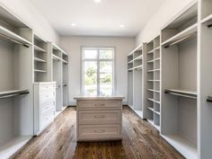 5602 Sugar Hill Houston, TX 77056: Photo A DREAM... Her Master Closet has a large double window which provides plenty of natural light. The Custom Built-Ins mix hanging spaces with shelving for Shoes and Purses. A large central Packing Island has big drawers for accessories and jewelry.