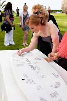 A surf board is the perfect guest book alternative for a beachy couple! http://www.stylemepretty.com/australia-weddings/new-south-wales-au/sydney/2015/08/27/16-creative-guest-book-alternatives-your-guests-will-want-to-sign/