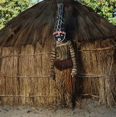 """""""Wearing a mask made of twigs, cardboard, and beeswax, this youth [in Zambia] — part of a coming-of-age ceremony — is dressed as one of the ancestral characters known as Likishi,"""" Galembo is quoted as saying by National Geographic."""